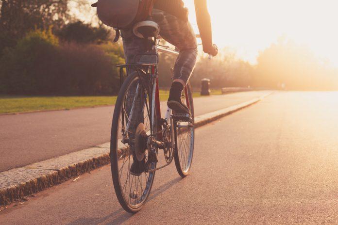 EU cycling economy cyclist sunset