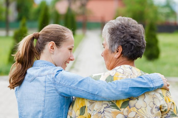 Old and young woman make personal budgets dementia friendly