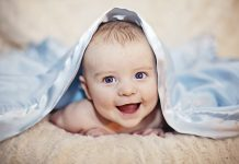 baby under blanket cognitive development in infancy