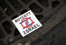 council boycotts israel sign on floor