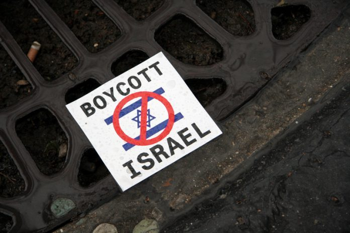 council boycotts israel sign on floor