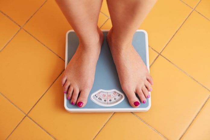 obesity epidemic and cancer woman scales